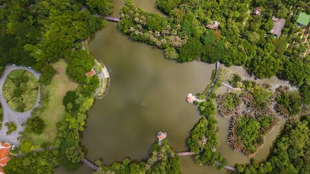 Aerial View of Sri Nakhon Khuean Khan Park and Botanical Garden is located in Bang Krachao, Phra Pradaeng, Samut Prakan Province, Thailand. Oasis in the middle of the concrete jungle