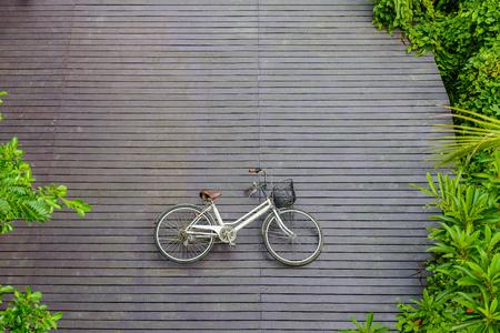 Vintage bicycle on wooden floor at Sri Nakhon Khuean Khan Park and Botanical Garden. Bang krachao, Phra Pradaeng, Samut Prakan, Thailand