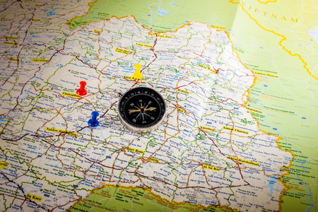 Closeup Compass on map with colorful pin Stock Photo