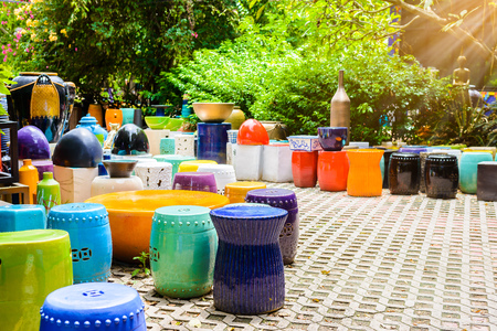multicolored ceramic bowls, Colorful pots and cups or vases handcrafted. Placement for gardening and walkways arrangement