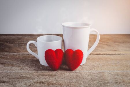 couple hearts and couple coffee cups on wooden table valentine s