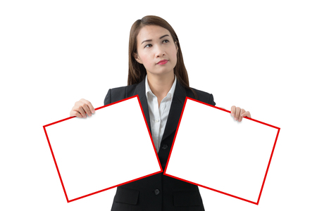 Asian Business woman holding two banner two hands isolated on Gradient background from white to black with clipping path. Alternative, Choice, Yes 0r No concepts Stock Photo