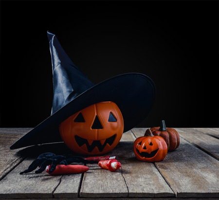 halloween background with Pumpkins, Witch hat, Black spider on wooden floor background Stock Photo