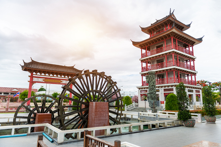 Water wheel and Tower decorated in Chinese style at The Celestial Dragon Village, Suphanburi, Thailand