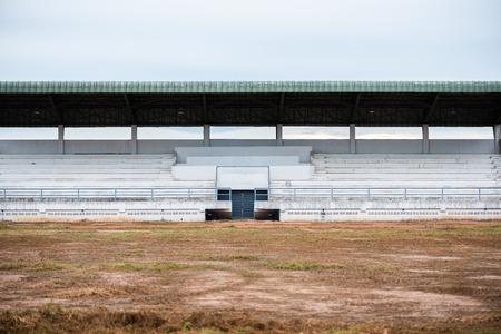 Empty Old grandstand for sports cheer with Lawn dry, Dry grass