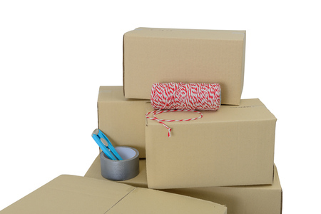 Cardboard boxes in different sizes stacked boxes, Adhesive tape, rope and Cutter isolated on white background