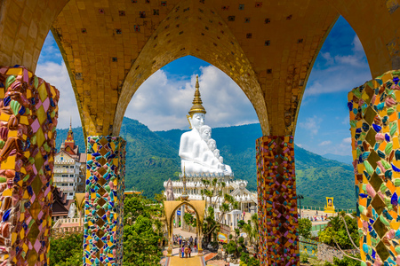 Phetchabun, Thailand- Oct 05, 2018; Big White Five buddha Statue in Wat Phra That Pha Son Kaew temple at Phetchabun Thailand. view from pagoda