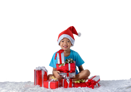 portrait of happy little asian boy with Many gift boxes isolated on white background