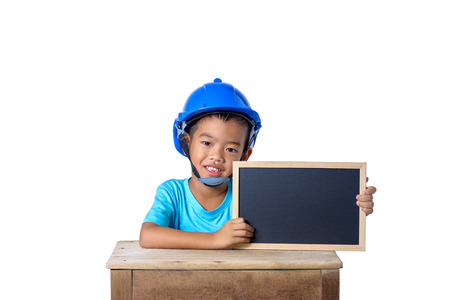 Asian children wearing safety helmet and smiling with chalkboard isolated on white background . Kids and education concept 스톡 콘텐츠
