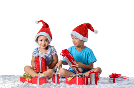 portrait of happy little asian boy and girl with Many gift boxes isolated on white background