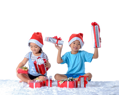 portrait of happy little asian boy and girl with Many gift boxes isolated on white background with clipping path Reklamní fotografie