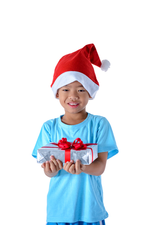 portrait of happy little asian boy holding gift boxes isolated on white background with clipping path