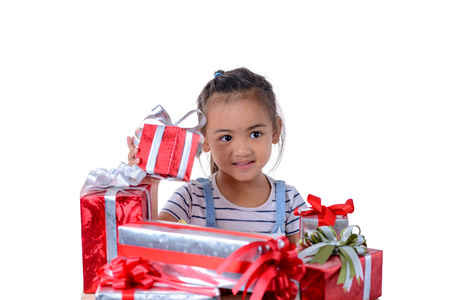 portrait of happy little asian girl with Many gift boxes isolated on white background with clipping path Stockfoto