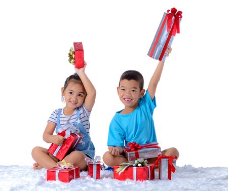 portrait of happy little asian boy and girl with Many gift boxes isolated on white background with clipping path 写真素材