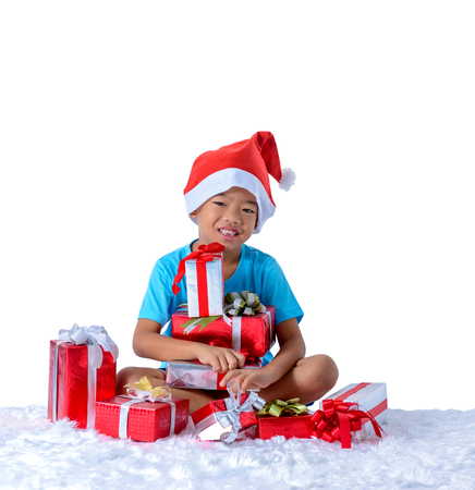 portrait of happy little asian boy with Many gift boxes isolated on white background with clipping path