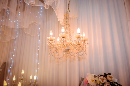 Chrystal chandelier lamp with white curtain Decorative elegant vintage and Contemporary interior or wedding ceremony Concept