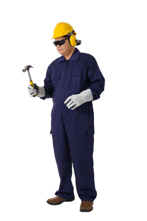 Full body portrait of a worker in Mechanic Jumpsuit is Holding a hammer with helmet, earmuffs, Protective gloves and Safety goggles isolated on white background clipping path