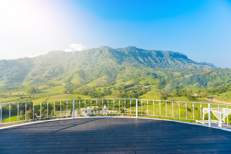 Khao Kho Viewpoint and great mountain view as background with wooden stage for standing photo in sunset time. Scenic popular for traveler