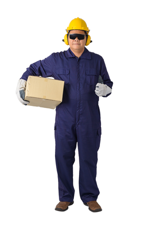 portrait of a worker in Mechanic Jumpsuit with helmet, earmuffs, Protective gloves and Safety goggles Was carrying a box isolated on white background clipping path