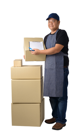Full Body portrait of delivery man in Black shirt and apron with stack of boxes is carrying parcel and presenting receiving form isolated on the white background