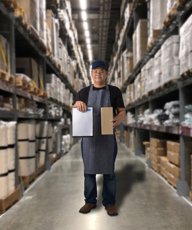 Worker Delivering products Sign the signature on the product receipt form with parcel boxes Blurred the background of the warehouse