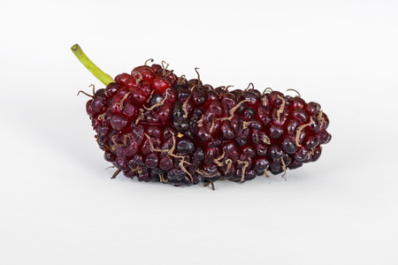 Organic Mulberry fruits on white background