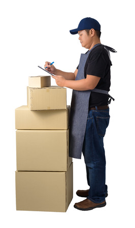 Full Body portrait of delivery man in Black shirt and apron with stack of boxes is Checking Products isolated on the white background with clipping path Stock fotó