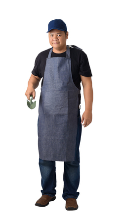 Full body portrait of a worker man or Serviceman in Black shirt and apron is holding Shovel for Cultivators isolated on white background clipping path. Hand-made, DIY, Garden concept