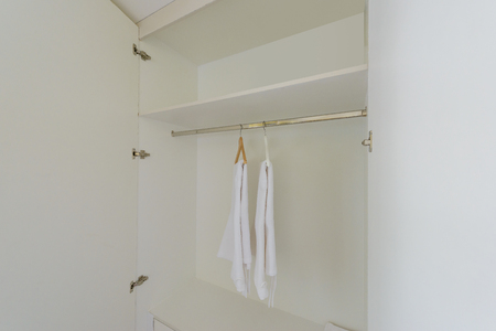 white wardrobe closet with Hangers, bath robes For guests staying in hotel