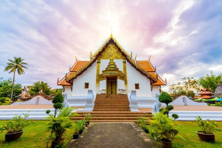 Wat Phumin, Muang District, Nan Province, Thailand. public place, the most famous temple with blue sky in morning Фото со стока
