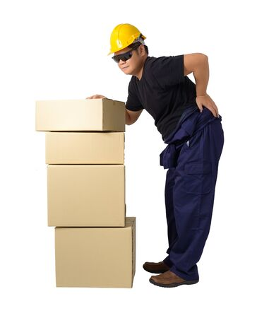 Delivery man lifting heavy weight boxes against having a backache isolated on white background clipping path