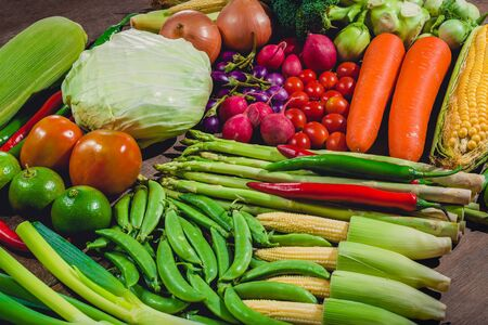 Background group of fresh food tasty and healthy vegetables are on the wooden table