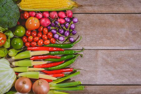 Background of fresh food tasty and healthy vegetables are on the wooden table with space for your message