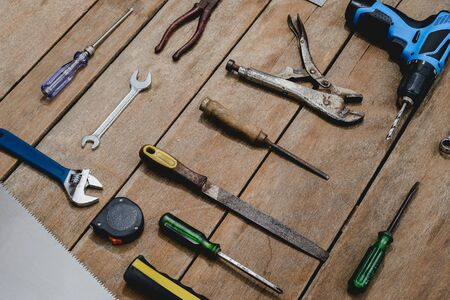 Top view of old instruments constructor or renovation for build and repair house on rustic grunge wooden background Standard-Bild