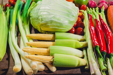 Backgroud group of fresh food tasty and healthy varis vegetables are on the wooden table Stock Photo