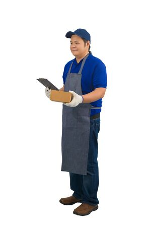 asian delivery man working in blue shirt with apron and protective gloves hand holding parcel and clipboard for checklist or receiving form isolated white background