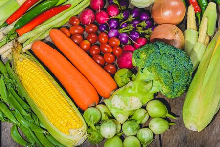 Backgroud group of fresh food tasty and healthy varis vegetables are on the wooden table 스톡 콘텐츠
