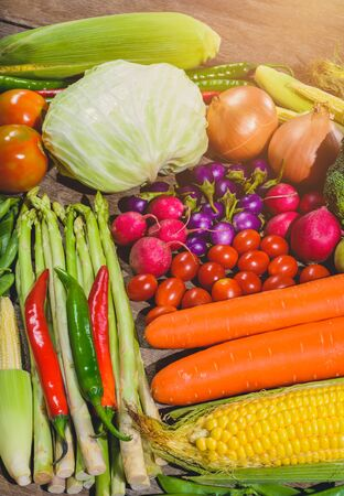 Backgroud group of fresh food tasty and healthy varis vegetables are on the wooden table Banco de Imagens