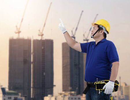 Portrait of Male Construction foreman supervisor or worker with Protection Equipment and blurred background is construction site