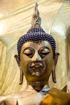 buddha head in wat lamphon, thailand photo