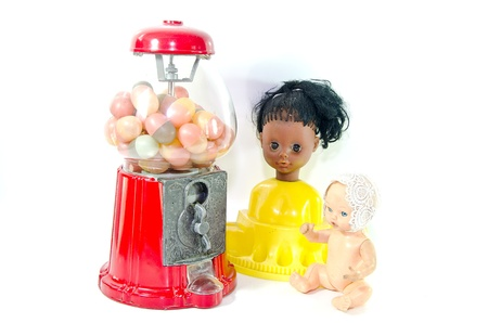 Isolated candy vending machine doll toy  photo