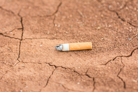 foolishness: cigarette carelessly thrown into red soi
