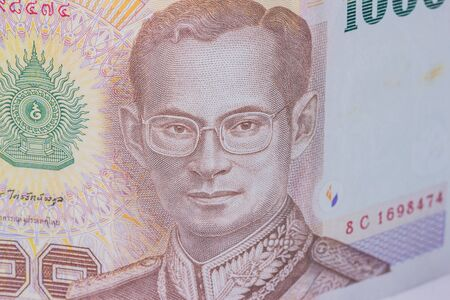 denomination: Close up of thailand currency, thai baht with the images of Thailand King. Denomination of 1000 bahts.