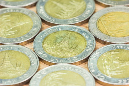 depicted: Coins of Thailand. Wat Arun Temple in Bangkok, Thailand, depicted in the Thai ten baht coin. Stock Photo