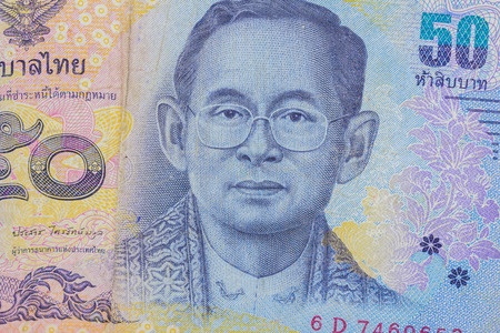 denomination: Close up of thailand currency, thai baht with the images of Thailand King. Denomination of 50 bahts. Stock Photo