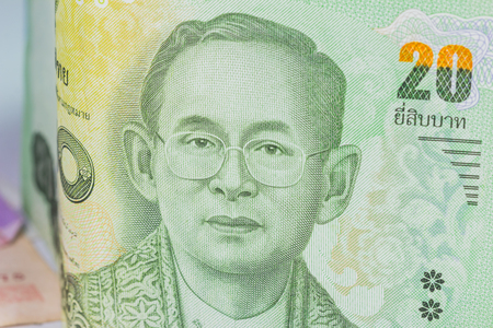 denomination: Close up of thailand currency, thai baht with the images of Thailand King. Denomination of 20 bahts.