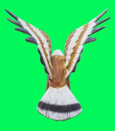 turn back: turn back Eagle or Falcon statueIsolated on green screen chroma key background.
