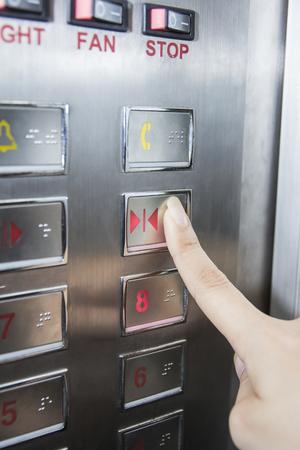 hand press: hand press open door button in elevator