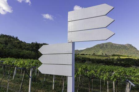 grass field: wooden sign on field grass mountain