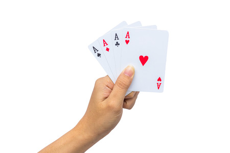 Playing cards in hand isolated on white background 版權商用圖片